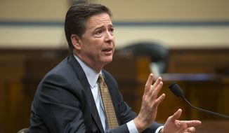 FBI Director James Comey testifies on Capitol Hill in Washington, Thursday, July 7, 2016, before the House Oversight and Government Reform Committee to explain his agency's recommendation to not prosecute Democratic presidential candidate Hillary Clinton over her private email setup during her time as secretary of state. (AP Photo/J. Scott Applewhite)