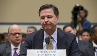 FBI Director James Comey pauses while testifying on Capitol Hill in Washington, Thursday, July 7, 2016, before the House Oversight Committee to explain his agency's recommendation to not prosecute Hillary Clinton, now the Democratic presidential candidate, over her private email setup during her time as secretary of state.  (AP Photo/J. Scott Applewhite)