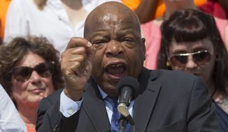 "Rep. John Lewis of Georgia told marchers who'd arrived at the Capitol in a spontaneous, permitless march from the White House that ""we stand with you."" (Associated Press)"