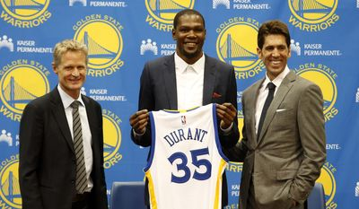 Golden State Warriors' newest player Kevin Durant, center, joins head coach Steve Kerr, left and general manager Bob Myers during a news conference at the NBA basketball team's practice facility, Thursday, July 7, 2016, in Oakland, Calif. (AP Photo/Beck Diefenbach) **FILE**