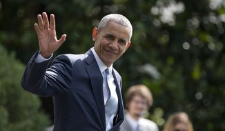 President Barack Obama waves to media as he walks across the South Lawn of the White House in Washington, to board Marine One, Thursday, July 7, 2016, for the short trip to Andrews Air Force Base, Md., and to Warsaw, Poland to attend the 2016 NATO Summit. (AP Photo/Carolyn Kaster)
