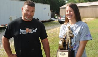 ADVANCE FOR THE WEEKEND OF JULY 9-10 AND THEREAFTER - In a June 29, 2016 photo, Chris Wollford and his daughter Kinley Wolfford, 12, talk about her accomplishments in drag racing in Mauriceville, Texas.  (Guiseppe Barranco/The Enterprise via AP)