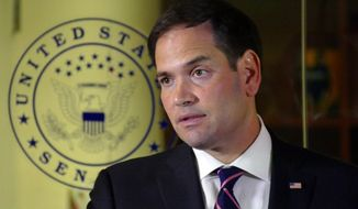 Sen. Marco Rubio, R-Fla., addresses the media at his Doral Headquarters, Friday afternoon, July 8, 2016, in Doral, Fla. Rubio spoke about the Dallas police shootings and the recent shootings of civilians, Philando Castile and Alton Sterling. (Emily Michot/Miami Herald via AP)