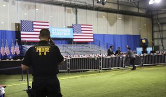 A police officer stands in a nearly empty room after a campaign event with Vice President Joe Biden and Democratic presidential candidate Hillary Clinton was canceled, Friday, July 8, 2016, in Scranton, Pa. The event was canceled because of the shootings in Dallas. Snipers opened fire on police officers in the heart of Dallas Thursday night, during protests over two recent fatal police shootings of black men. (AP Photo/Mel Evans)