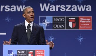 President Barack Obama makes a statement following a meeting with Polish President Andrzej Duda, Friday, July 8, 2016, at PGE National Stadium in Warsaw, Poland. Obama is in Warsaw to attend the NATO Summit. (AP Photo/Susan Walsh)