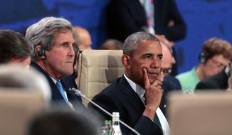 President Barack Obama waits next to State Secretary John Kerry for the start of the first working session of the North Atlantic Council at the NATO summit in Warsaw, Poland, Friday, July 8, 2016. Starting Friday, US President Barack Obama and leaders of the 27 other NATO countries will take decisions in Warsaw on how to deal with a resurgent Russia, violent extremist organizations like Islamic State, attacks in cyberspace and other menaces to allies' security during a summit described by many observers as NATO's most crucial meeting since the 1989 fall of the Berlin Wall.(AP Photo/Markus Schreiber)