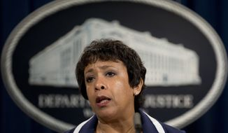 "Attorney General Loretta Lynch speaks about recent shootings, Friday, July 8, 2016, at the Justice Department Washington. Lynch said the Dallas police shootings were ""an unfathomable tragedy"" in a week of ""profound heartbreak and loss,"" but violence is not the answer.  (AP Photo/Carolyn Kaster)"