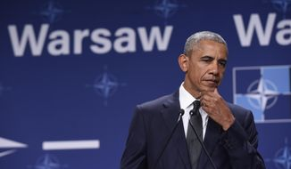 President Barack Obama listens as Polish President Andrzej Duda makes a statement following their meeting at PGE National Stadium in Warsaw, Poland, Friday, July 8, 2016. Obama is in Warsaw to attend the NATO Summit. (AP Photo/Susan Walsh)