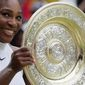 Serena Williams of the U.S holds up her trophy after beating Angelique Kerber of Germany in the women's singles final on day thirteen of the Wimbledon Tennis Championships in London, Saturday, July 9, 2016. (AP Photo/Tim Ireland)