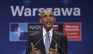 President Barack Obama speaks about the events in Dallas at the beginning of his news conference at PGE National Stadium in Warsaw, Poland, Saturday, July 9, 2016. Obama is in Warsaw attending the NATO Summit. (AP Photo/Susan Walsh)