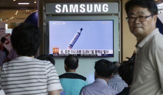 People watch a TV news program showing a file footage of North Korea's ballistic missile that the North claimed to have launched from underwater, at Seoul Railway station in Seoul, South Korea, Saturday, July 9, 2016. North Korea on Saturday fired what appeared to be submarine-launched ballistic missile off its eastern coast, the U.S. and South Korea said, in the latest test that's part of efforts by the North to advance technology capable of delivering nuclear warheads. (AP Photo/Ahn Young-joon)