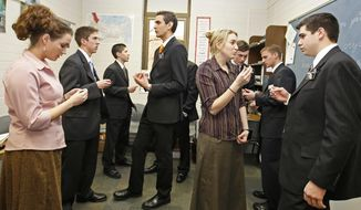 In this Jan. 31, 2008, photo, a class of Mormon missionaries practice the Russian language with each other at the Mormon Missionary Training Center in Provo, Utah. Mormon missionaries will remain in Russia despite the country's new anti-terrorism law, which will put greater restrictions on religious work starting later this month. In a statement issued Friday, July 8, 2016, the Church of Jesus Christ of Latter-day Saints said that missionaries will respect a measure that Russian President Vladimir Putin signed into law this week. (AP Photo/George Frey, File)