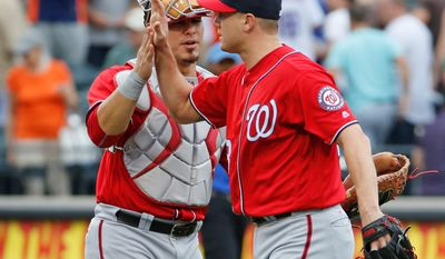 Washington catcher Wilson Ramos (left) and reliever Jonathan Papelbon closed out a 3-2 Nationals win on Sunday.