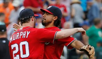 The Washington Nationals' Daniel Murphy and third baseman Anthony Rendon have reason to celebrate heading into the all-star break with a six-game lead in the NL East. (Associated Press Photographs)