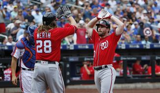 Washington Nationals Jayson Werth (28) greets Washington Nationals Daniel Murphy at the plate after scoring on Murphy's, first-inning, two-run, home run in a baseball game against the New York Mets, Sunday, July 10, 2016, in New York. (AP Photo/Kathy Willens)