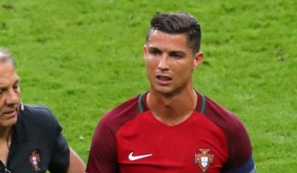 Portugal's Cristiano Ronaldo reacts as he leaves the pitch during the Euro 2016 final soccer match between Portugal and France at the Stade de France in Saint-Denis, north of Paris, Sunday, July 10, 2016. (AP Photo/Thibault Camus)