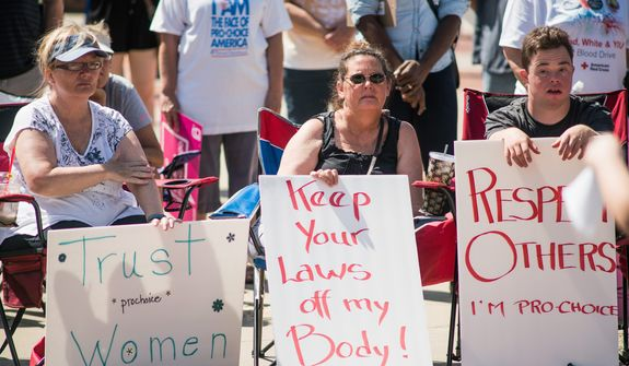 A craw in the ongoing abortion debate centers on the Hyde Amendment, which bars federal funds from paying directly for abortions. The Democratic Party aims to strip the Hyde language from its 2016 platform. (Associated Press)
