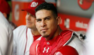 Nationals catcher Wilson Ramos has reason to smile at Tuesday's All-Star Game after overcoming a trade, kidnapping scare, injuries and a death in the family in his career. (Associated Press) **FILE**
