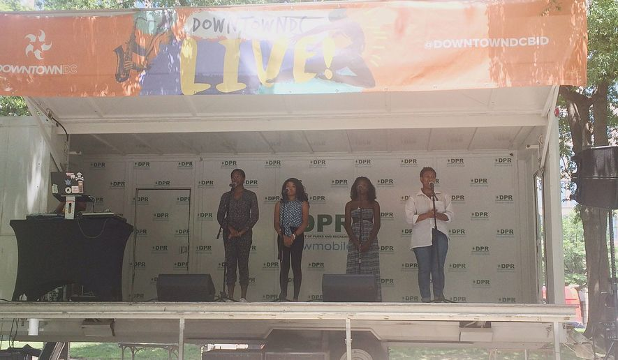 Members of the DC Youth Slam Team, (from left) Bobbi Johnson, Gaelyn Smith, Eliamani Ismail, and Zahra Wardrick, practice for Brave New Voices. (Emily Kim / The Washington Times)