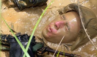 U.S. Marine Corps 2nd Lt. Daniel Mora trains at the Jungle Warfare Training Center on Camp Gonsalves, Okinawa, Japan, Aug. 21, 2009. (U.S. Marine Corps) ** FILE **