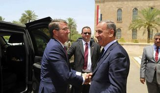 Visiting U.S. Defense Secretary Ashton Carter, left, shakes hands with Iraqi Defense Minister Khaled al-Obeidi at the Ministry of Defense, Baghdad, Iraq, Monday, July 11, 2016. (AP Photo)