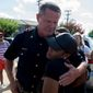 Officer W. C. Humphrey embraces Kristen Duncan, 25, of Arlington, Texas, during the Black Lives Matter rally on Sunday, July 10, 2016 in Dallas. (Ting Shen/The Dallas Morning News via AP)