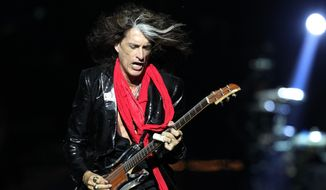 In this Saturday, May 25, 2013, file photo, lead guitarist Joe Perry, of American rock band Aerosmith, performs in Singapore during the inaugural Social Star Awards concert. Aerosmith co-founder and guitarist Perry has been taken to a hospital after he was forced to leave the stage while performing in New York City. Perry became ill on Sunday. July 11, 2016, while performing with Johnny Depp and Alice Cooper in his side band, the Hollywood Vampires, at Ford Amphitheater at the Coney Island boardwalk in Brooklyn. (AP Photo/Wong Maye-E, File)