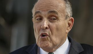 """FILE - In this Oct. 16, 2014 file photo, lawyer and former New York City Mayor Rudy Giuliani calls for the dismissal of a lawsuit filed against video game giant Activision by former Panamanian dictator Manuel Noriega outside Los Angeles Superior court in Los Angeles. During an appearance on CBS' """"Face the Nation"""" on Sunday, July 10, 2016, Giuliani said saying the term """"black lives matter"""" is """"inherently racist."""" (AP Photo/Damian Dovarganes, File)"""