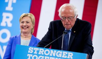 Sen. Bernie Sanders, I-Vt., accompanied by Democratic presidential candidate Hillary Clinton, speaks during a rally in Portsmouth, N.H., Tuesday, July 12, 2016, where Sanders endorsed Clinton for president. (AP Photo/Andrew Harnik)