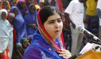 Malala Yousafza speaks to refugees in the Dadaab refugee camp, Kenya, Tuesday, July 12, 2016. Nobel laureate Malala Yousafzai is spending her 19th birthday in Kenya Tuesday visiting the world's largest refugee camp to draw attention to the global refugee crisis, especially as Dadaab camp faces pressure to close after a quarter-century. (AP Photo/Khalil Senosi)