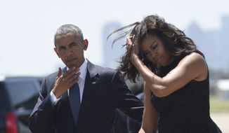 President Barack Obama and first lady Michelle Obama arrive via Air Force One at Dallas Love Field in Dallas, Tuesday, July 12, 2016. Obama will speak at an interfaith memorial service for the fallen police officers and members of the Dallas community at the Morton H. Meyerson Symphony Center in Dallas. (AP Photo/Susan Walsh)