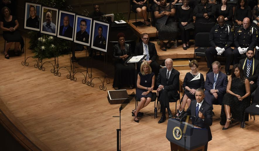 President Barack Obama speaks at an interfaith memorial service for the fallen police officers and members of the Dallas community at the Morton H. Meyerson Symphony Center in Dallas, Tuesday, July 12, 2016. Behind him, from left are, Jill Biden, Vice President Joe Biden, former first lady Laura Bush, former President George W. Bush and first lady Michelle Obama.  (AP Photo/Susan Walsh)