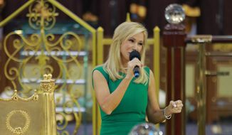 Televangelist Paula White in a 2014 photo from her eponymous website. Accessed July 12, 2016. [https://www.paulawhite.org/images/image-gallery/ghana-dec2014/AT3A9705.jpg]