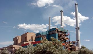 FILE - This April 28, 2010 file photo shows the Colstrip Steam Electric Station, a coal-fired power plant in Colstrip, Mont. The Colstrip plant, a coal plant serving utility customers across the Pacific Northwest, has agreed to shut down two of its four units by 2022 under a settlement announced Tuesday, July 12, 2016, with environmentalists who sued over alleged air pollution violations. (AP Photo/Matt Brown, file)