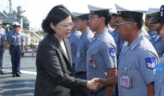 In this image taken and made available by the Taiwan Presidential Office on Wednesday, July 13, 2016, Taiwan's President Tsai Ing-wen shakes hands with crew members aboard a Taiwan Navy ship before it sets out to patrol in the South China Sea from the naval base in the southern port city of Khaohsiung, Taiwan. Taiwan's Ministry of National Defense said Wednesday it will continue to send planes and ships to the South China Sea to carry out patrol missions and defend Taiwan's territory and sovereignty despite the Permanent Court of Arbitration's ruling in The Hague, said the Central News Agency.  (Taiwan Presidential Office via AP)