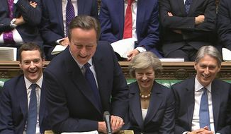 "In this grab taken from video British Prime Minister David Cameron, centre, smiles, during his final session of prime minister's questions at the House of Commons, in London, Wednesday, July 13, 2016. He joked that his afternoon schedule ""will be light"" after he steps down following a brief visit with Queen Elizabeth II. Cameron will tell the queen at Buckingham Palace he is resigning and suggest that Home Secretary Theresa May has the support to become prime minister. In the background are Chancellor George Osborne, Home Secretary Theresa May and Foreign Secretary Phillip Hammond, from left. (Parliamentary Recording Unit via Associated Press Video)"