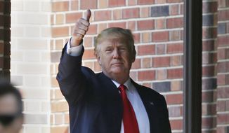 Republican presidential candidate Donald Trump gives a thumbs-up as he leaves the residence of Indiana Gov. Mike Pence in Indianapolis, Wednesday, July 13, 2016. (AP Photo/Michael Conroy)