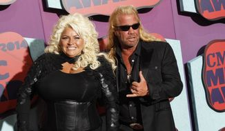 In this June 4, 2014, photo, Beth Chapman, left, and Duane Chapman arrive at the CMT Music Awards at Bridgestone Arena, in Nashville, Tenn. (Photo by Wade Payne/Invision/AP, File) **FILE**