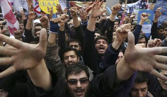 In this Nov. 4, 2015 photo, Iranian demonstrators chant slogans during an annual rally in front of the former U.S. Embassy in Tehran. The annual state-organized rally drew greater attention, as Iranian hardliners are intensifying a campaign to undermine President Hassan Rouhani's outreach to the West following a landmark nuclear deal reached with world powers in July. The Iran nuclear accord is fragile at its one-year anniversary. Upcoming elections in the U.S. and Iran could yield new leaders determined to derail the deal. The Mideast wars pit U.S. and Iranian proxies in conflict, with risks of escalation. Iran's ballistic missiles are threatening American allies in the Arab world and Israel, raising pressure on the United States to respond with force. (AP Photo/Vahid Salemi, File)