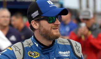 Dale Earnhardt Jr. waits by his car before the start of the NASCAR Sprint Cup Series auto race at Daytona International Speedway, Saturday, July 2, 2016, in Daytona Beach, Fla. (AP Photo/John Raoux)