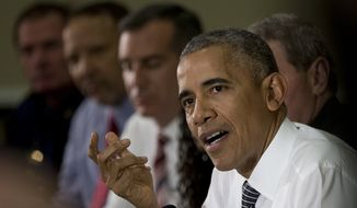 President Barack Obama speaks to media at the bottom of a meeting at the Eisenhower Executive Office Building on the White House complex in Washington, Wednesday, July 13, 2016, about community policing and criminal justice with a group made of activists, civil rights, faith, law enforcement and elected leaders. (AP Photo/Carolyn Kaster)