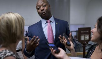 In this June 21, 2016, file photo, Sen. Tim Scott, R-S.C., talks with reporters on Capitol Hill in Washington. (AP Photo/Alex Brandon, File)