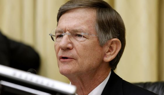 House Science Committee Chairman Rep. Lamar Smith, R-Texas, speaks on Capitol Hill in Washington in this June 7, 2012, file photo. (AP Photo/Charles Dharapak, File)