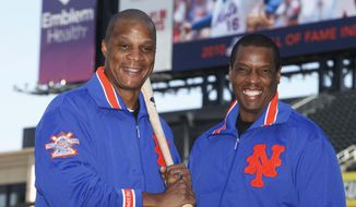 "FILE - This Aug. 1, 2010, file photo shows former New York Mets' players Dwight Gooden, right, and Darryl Strawberry posing at Citi Field in New York. ESPN's latest ""30 for 30"" documentary, ""Doc & Darryl,"" examines their relationship. The film premieres Thursday at 9 p.m. EDT, two nights after the All-Star game. (AP Photo/Seth Wenig, File)"