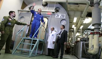 This Nov. 4, 2011, photo released by Moscow's Institute for Medical and Biological Problems Russia, shows researcher Sukhrob Kamolov leaving a set of windowless modules after a grueling 520-day simulation of a flight to Mars. (Associated Press/IMBP, Oleg Voloshin) **FILE**