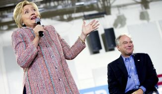 Democratic presidential candidate Hillary Clinton, accompanied by Sen. Tim Kaine, D-Va., right, speaks at a rally at Northern Virginia Community College in Annandale, Thursday, July 14, 2016. (AP Photo/Andrew Harnik)