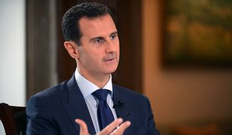 In this photo released on Thursday, July 14, 2016, by the Syrian official news agency SANA, Syrian President Bashar Assad, speaks during an interview with American network NBC News, in Damascus, Syria. (SANA via AP)
