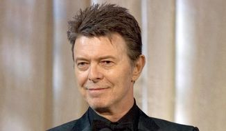 In this June 5, 2007, photo, singer David Bowie accepts the lifetime achievement award at the 11th Annual Webby Awards in New York. Sotheby's is to sell more than 200 pieces from David Bowie's extensive art collection, including works by Damien Hirst and Jean-Michel Basquiat. The musician, who died in January 2016, was an avid collector, and served on the editorial board of Modern Painters magazine. (AP Photo/Stephen Chernin, File) **FILE**