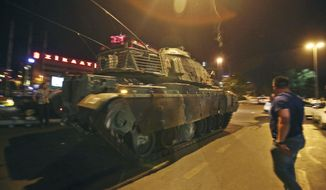 "A tank moves into position as Turkish people attempt to stop them, in Ankara, Turkey, early Saturday, July 16, 2016. Turkey's armed forces said it ""fully seized control"" of the country Friday and its president responded by calling on Turks to take to the streets in a show of support for the government. A loud explosion was heard in the capital, Ankara, fighter jets buzzed overhead, gunfire erupted outside military headquarters and vehicles blocked two major bridges in Istanbul. (AP Photo)"