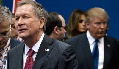 In this Feb. 6, 2016, file photo, Ohio Gov. John Kasich, left, and Donald Trump, right, speak to reporters after a Republican presidential primary debate hosted by ABC News at Saint Anselm College in Manchester, N.H. (AP Photo/Matt Rourke, File)